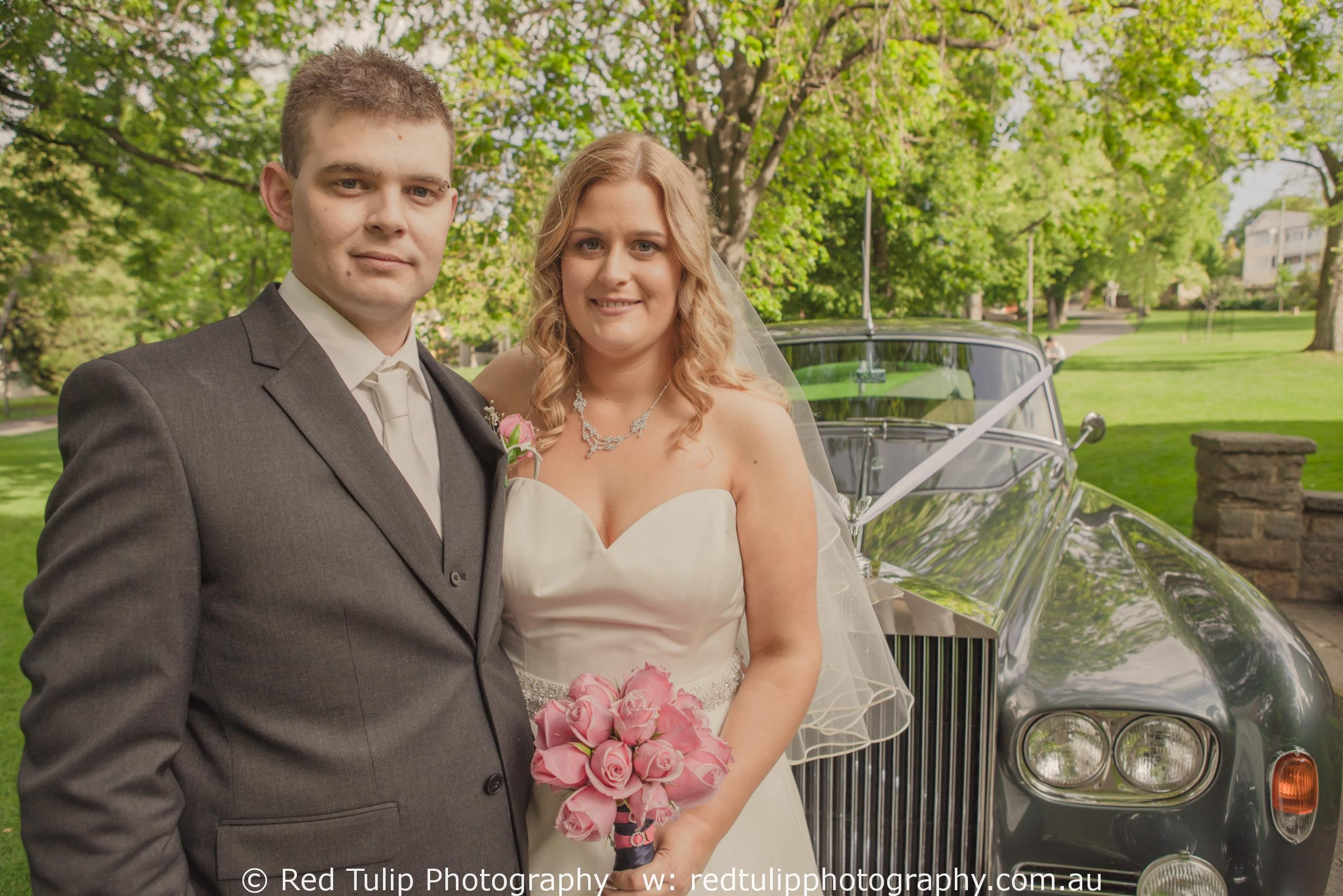 Wedding couple portrait with car