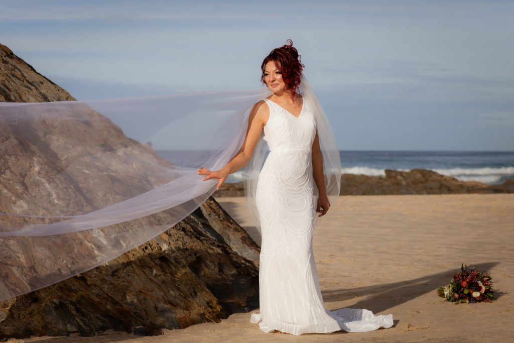 Bride in a sheath gown at Currumbin Beach on the Gold Coast